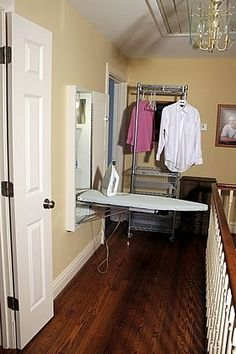 Hallway Laundry Closet And Ironing Center A Solution For Small Spaces Theyummylife
