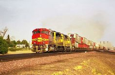 https://flic.kr/p/Ps4Quu | AT&SF GP60M 141 | April of 1998 BNSF Eastbound Doublestack Container Train passes through Daggett, CA