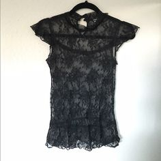 Black lace top Black lace top with cute details Wet Seal Tops