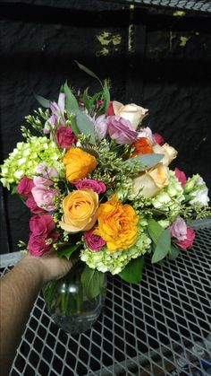 Look at all those colors in this beautiful wedding bouquet! americasflorist.com