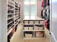 The design behind this master suite's closet was a shoe wall to display all of her shoes, ample storage so there are no dressers in the bedroom, and pull down rods for the top hanging clothes for accessibility. Laguna Hills, Shoe Wall, Hanging Clothes, Plan Design, Master Suite, Custom Homes, Modern Contemporary, Floor Plans, Flooring
