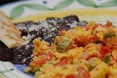 Everybody's version of Eggs a la Mexicana can vary. Here's mine (and my dad's, too).