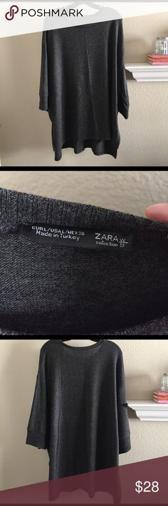 "NWOT Zara gray sweater NWOT Zara charcoal gray sweater. Size Large. 3/4 sleeve. Incredibly soft and comfy with the front a little shorter than the back. 3"" slits up the sides of sweater. 76% polyester 21% viscose 3% elastane. Zara Sweaters"