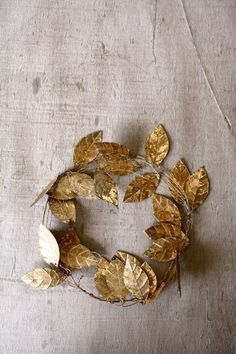 Gilded leaves | You could use this for the flower girl(s) and other children in the wedding party! Would be adorable.