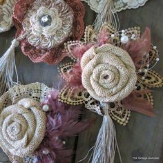 Like this for flower corsage! Idea - layer handmade rolled fabric Rose onto lace rosette, onto small doily; adhere tassel or bead/pearl strands behind Rose. :)