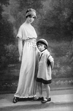 A woman and child modeling Belle Epoque era dresses by designer Jeanne Lanvin…
