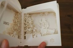 tree_01 - 360 degree christmas book by Yusuke Oono. From designboom. I couldn't find a website for Y.O. It's lovely open, see other photo.