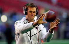 Quarterback Tom Brady of the New England Patriots warms up prior to Super Bowl XLIX against the Seattle Seahawks at University of Phoenix Stadium on Feb, 1 in Glendale,
