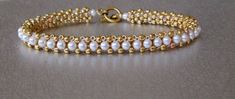 yellow gold pearl beadwork tennis bracelet on Etsy, $70.40 Handmade Bridal Jewellery, Handmade Bracelets, Seed Bead Bracelets, Pearl Bracelet, Beaded Bracelet, Seed Beads, Beaded Jewelry Patterns, Gold Pearl, Pearl White