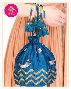 Silk potli-bag with hand-embroidered fish motifs and handmade tassels  #tishasaksena #whitemughals