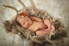 Newborn girl. Antlers. Hunting.