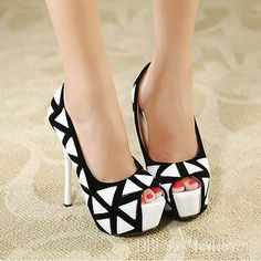 Love Black and White Classic. Rock your next business meeting with these stillettos, heads will turn.