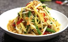 Som Tam is just another name for Thai Papaya Salad. This is a Thai essential!
