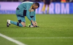 Arsenal's Colombian goalkeeper David Ospina adjusts his boots during the UEFA Champions League Round of 16 second leg football match FC Barcelona vs Arsenal FC at the Camp Nou stadium in Barcelona on March 16, 2016.