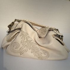 Cole Haan Embellished Leather Purse Gorgeous Cole Haan embellished leather bag in excellent condition. Cream leather with beautiful embroidery embellishment and a pocket on either side. Wear on the strap rings otherwise excellent condition. Cole Haan Bags