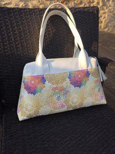 Sac City Zip-Zip en simili blanc et rosaces cousu par Nathalie - Patron Sacôtin