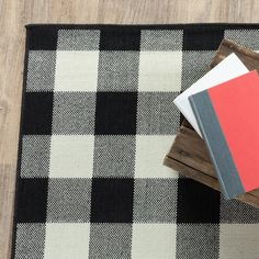 Experience plaid perfection with this StyleHaven Mainland Gingham indoor and outdoor rug. In black/ivory. Indoor Outdoor Area Rugs, Outdoor Planters, White Area Rug, White Rug, Patio Rugs, Hand Tufted Rugs, Neutral Palette, Porch Decorating, Rug Size