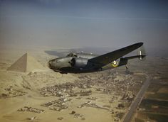 The Second World War - in color. A Royal Air Force Lockheed Hudson Mk VI (AE626) of the Middle East Communications Flight flying over the pyramids.