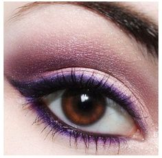 Eye make-up...maybe a dark blue and or silver