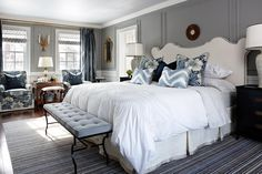 Traditional bedroom with picture frame moulding walls painted white and gray, by Sarah Richardson