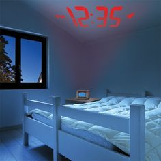 AcuRite Projection Alarm Clock with Atomic Time & Temperature features an easy-to-read backlit screen with time, month / date, day of week and indoor temperature, a loud alarm and snooze button.