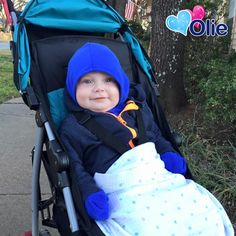 """Fan Photo Friday: """"Bundled up in our Minkey! This Makes me so much happier on our walks and he loves it too!"""" Thank you, Deidre! #olie #minkey #fanphoto #Friday #child #cute #fanlove"""