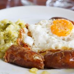 One of the BEST things we've eaten in Portugal Alheira smoked bread sausage with cabbage and port wine vinegar. #visitporto