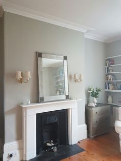 We painted the living room in Farrow & Ball Drop Cloth - a lovely grey/green