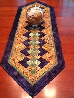 Beautiful table runner pattern. Colors for late summer, fall.