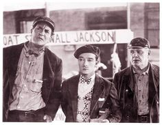 Ernest Torrence as Steamboat Bill, Buster as Willie Jr and Tom Lewis as the first mate