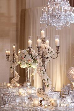 Garlands of roses add a beautiful pop to candelabras.