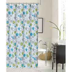 This fun bubble designed shower curtain offers blue and green designs on a white background. Crafted of quality polyester, this piece is conveniently machine washable.