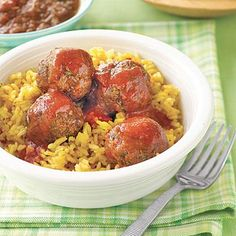 Looking for a quick weeknight dinner? Check out these Oven Baked Mexican Meatballs Over Rice!
