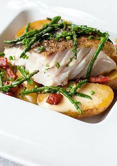 Pan-roast cod with confit Jersey Royals, pancetta, samphire and lemon - Graham Campbell. Seaside flavours of cod and samphire are mingled with terrestrial potatoes and pancetta for a superb main course that would be a real showstopper, whether for a dinner party or an intimate meal, this baked fish recipe will impress. #FishRecipes