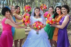 Colorful wedding  You know, this could work.  Pair the men with matching vest colors of the dress colors picked!
