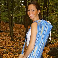 Your yoga mat looks cold. Wrap it up in our appropriately named Yoga Bag! This satchel will fit any mat, and its comfortable single shoulder strap makes it great for travel!  Features:    Drawstring with wooden clasp  Convenient outer pocket  Hand-sewn   Fashion changes quickly in the Nairobi markets; most of our prints are limited and one-time-only!