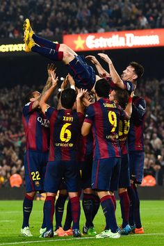 Lionel Messi of FC Barcelona celebrates with his teammates after scoring his team's fourth goal during the La Liga match between FC Barcelona and Sevilla FC at Camp Nou on November 22, 2014 in Barcelona, Catalonia. Lionel Messi beat the record for number of goals in the Spanish La Liga by scoring his 252nd goal, the previous record of 251 was held by Telmo Zarra.