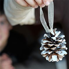 Have fun making ornaments for the Christmas tree with this simple idea that uses just pinecones and paint!
