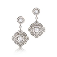 amond drop earrings from the Kwiat Vintage Collection in 18K white gold A vintage motif that plays on the contrast of modern brilliant and rose cut diamonds.