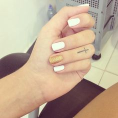 White nail polish with gold nail polish on the ring finger love it