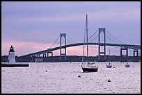Newport Bridge and Newport Harbor lighthouse at sunset. Newport, Rhode Island, USA (color)