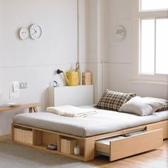 Bare Utility  A low, back-to-basics bed (albeit with some clever storage), a stripped back colour scheme and a few choice accessories make this bedroom one for fans of minimal utilitarian style.
