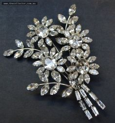 Lot 317 - Huge rhinestone floral spray with safety chain, c1950 9cms