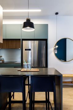 Green modern kitchen Designed by: Meital Irany & Sivan Goldfeld Photo by: Orit Arnon Modern Kitchen Design, Conference Room, House Styles, Green, Table, Furniture, Home Decor, Decoration Home, Room Decor