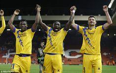 Sion's (L-R) Ebenezer Assifuah, Pa Modou Jagne and Vero Salatic celebrate after the game...
