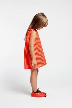 love the fabric, needs sleeves and some more length or pants underneath but I really like the bright orange with stripes