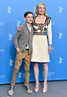 Two's company! Kirsten Dunst looked lovely as she attended a photo call at the Berlin Film Festival on Friday to promote her latest film, Midnight Special, alongside her 13-year-old co-star Jaeden Lieberher
