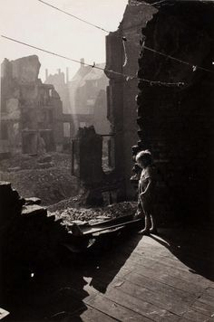 Photograph by David Seymour ~ A boy amid devastation in Essen ~ Germany ~ 1947 ~ From We Went Back: Photographs From Europe 1933-56 by Chim