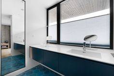 dark blue bathroom furniture from Antoniolupi's series Piana. Top and sink in Corian. Mixer from Vola
