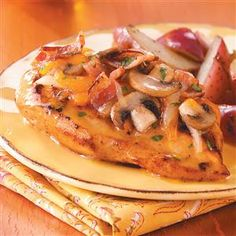 Bacon-Cheese Topped Chicken Recipe -Mushrooms, bacon strips and Monterey Jack cheese top these tender marinated chicken breasts that provide a flavorful dining experience with a just a little fuss. I get compliments whenever I serve them. They're one of my family's favorites. -Melanie Kennedy Battle Ground, Washington